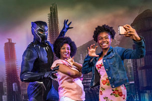 Guests meet Black Panther during Marvel Day at Sea aboard the Disney Magic