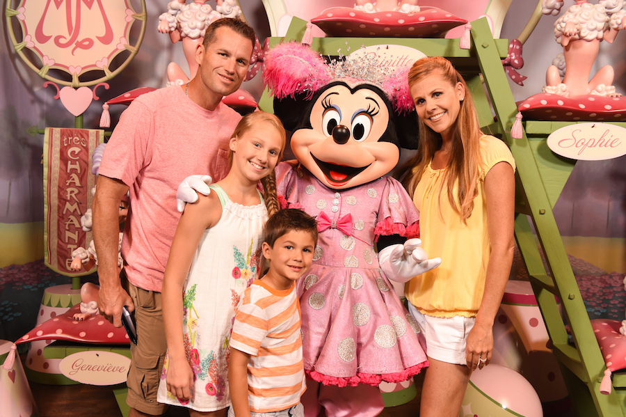 Family with Minnie Mouse at Magic Kingdom Park