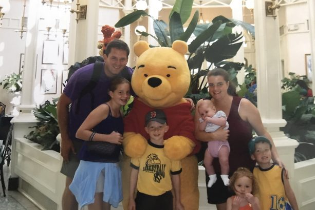 Disney Parks Moms Panelist Kaylene and her family with Pooh at The Crystal Palace