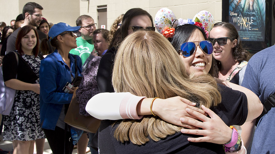 Guests hug at 'Wrinkle In Time' Meet-Up
