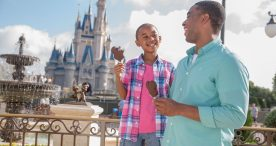Guests enjoy Mickey Premium Ice Cream Bars at Magic Kingdom Park