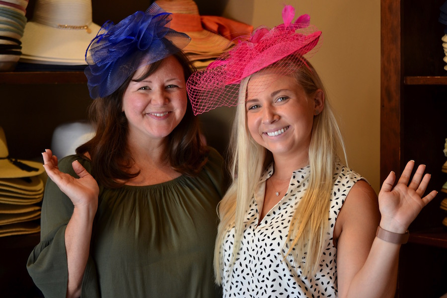 Guests pose with hats from Chapel Hats