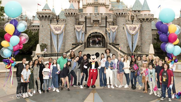 """Disney Channel GO"" fans pose with Mickey Mouse, Disneyland park"