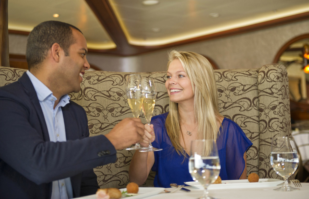 Guests enjoying dinner at Remy with Disney Cruise Line