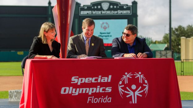 Special Olympics North America and Special Olympics Florida sign documents to bring the 2022 Special Olympics USA Games to Orlando