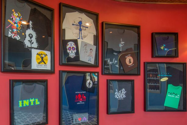 Wall of t-shirts in Lamplight Lounge at Disney California Adventure park
