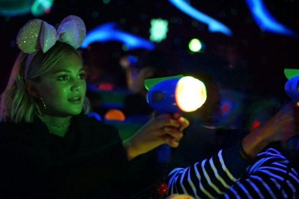 Freeform's 'Marvel's Cloak & Dagger' Stars Olivia Holt and Aubrey Joseph face off on Buzz Lightyear Astro Blasters at Disneyland park
