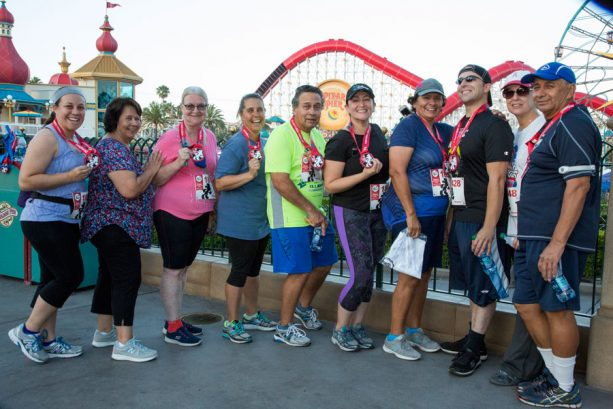 Cast Members pose with medals at the Cast Member, Friends and Family 5K at the Disneyland Resort