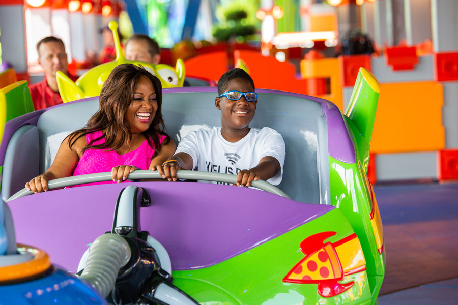 Sherri Shepherd and her son Jeffrey ride Alien Swirling Saucers in Toy Story Land at Disney's Hollywood Studios