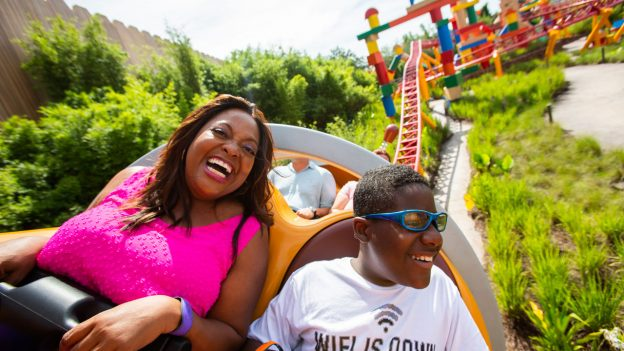 Sherri Shepherd and her son Jeffrey ride Slinky Dog Dash in Toy Story Land