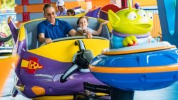 Tim Allen and his daughter ride Alien Swirling Sauers in Toy Story Land at Disney's Hollywood Studios