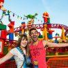 Disney Parks Blog Toy Story Land Celebration guests pose in front of Slinky Dog Dash