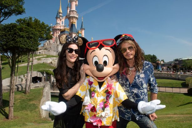 Liv and Steven Tyler pose with Mickey Mouse at Disneyland Paris