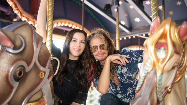 Liv and Steven Tyler ride Le Carrousel de Lancelot at Disneyland Paris