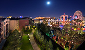 Hotel balconies overlook attractions of Disney California Adventure Park at night