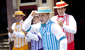 The Dapper Dans barbershop quartet performing in costume