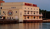 The exterior of the Atlantic Dance Hall, next to a lake