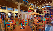 Pepper Market inside Disneys Coronado Springs Resort featuring tables with condiments, chairs, tile flooring, windows and bistro lights
