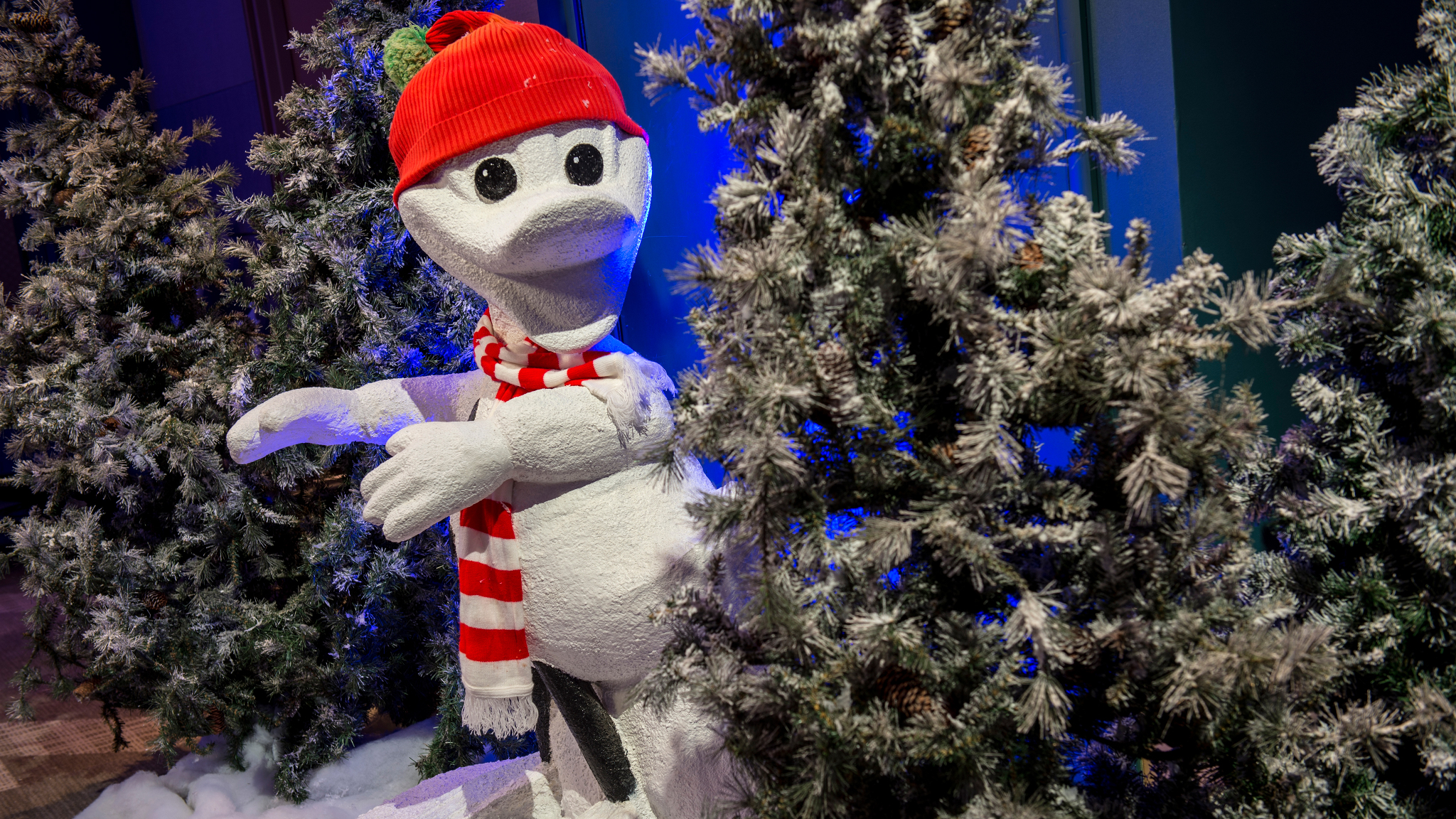A Donald Duck snowman and pine tree decorations