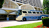 Disneys Magical Express motorcoach in front of a Disney Resort hotel