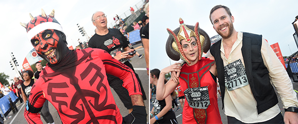 Man in Darth Maul outfit at finish line. - Couple in coordinating Star Wars outfits at finish line.