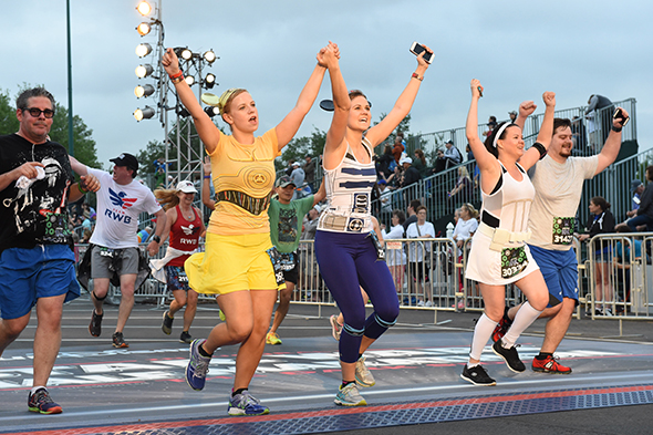 Runners cheering at Star Wars Half Marathon finish line