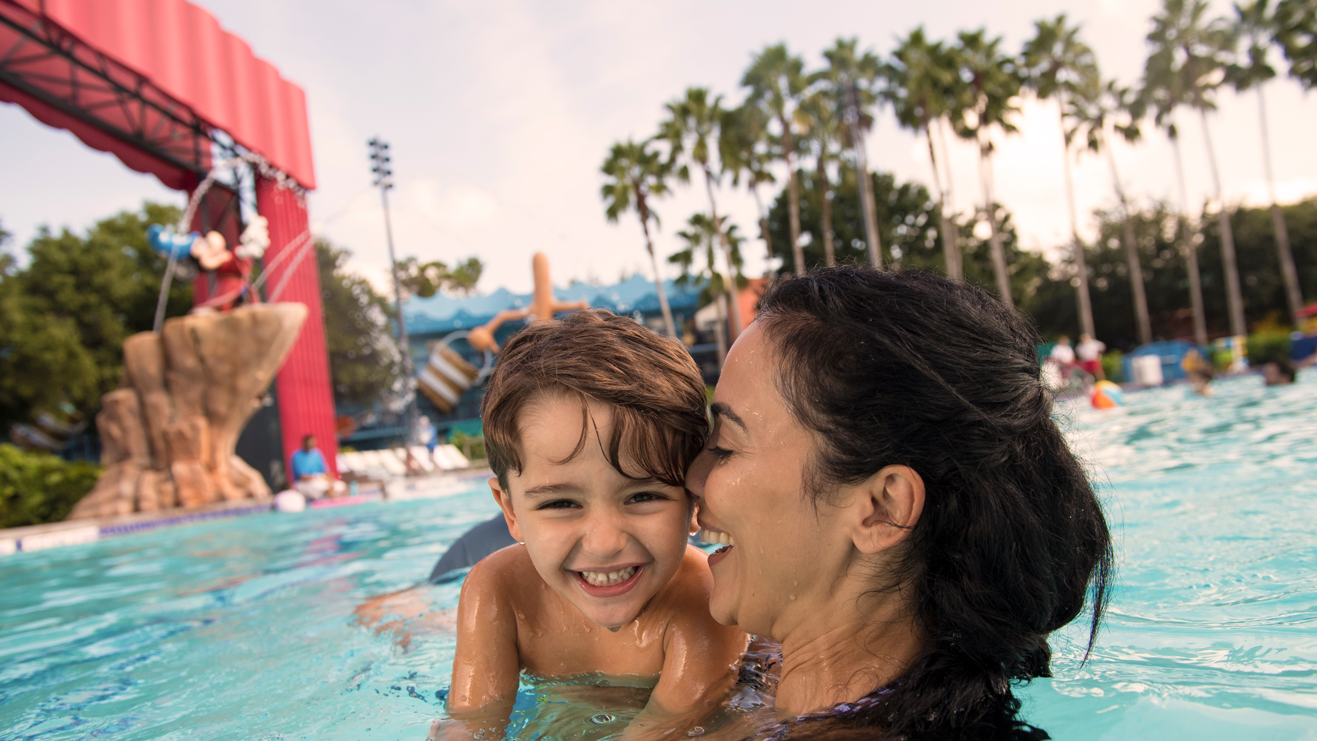 A mother and son enjoy pool time at Disney's Art of Animation Resort