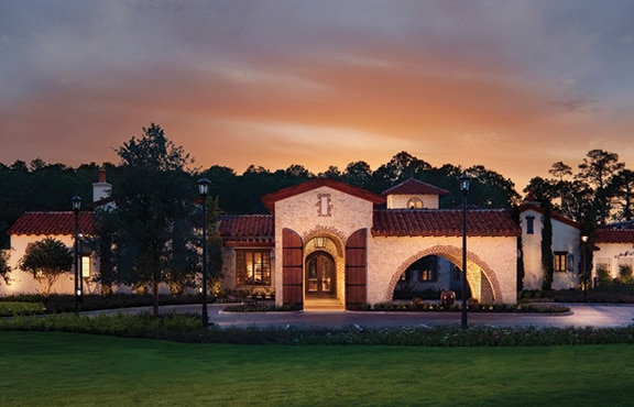 The Tuscan-style exterior of Summerhouse, a private clubhouse at Golden Oak