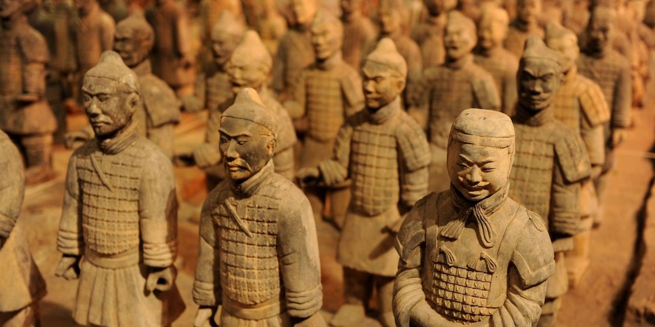Ancient terracotta sculptures of warriors, standing in formation