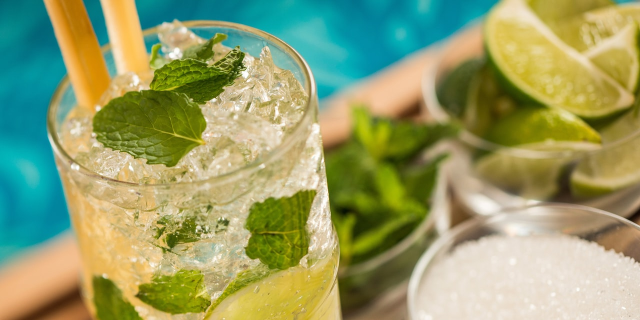 A mint filled mojito cocktail with limes
