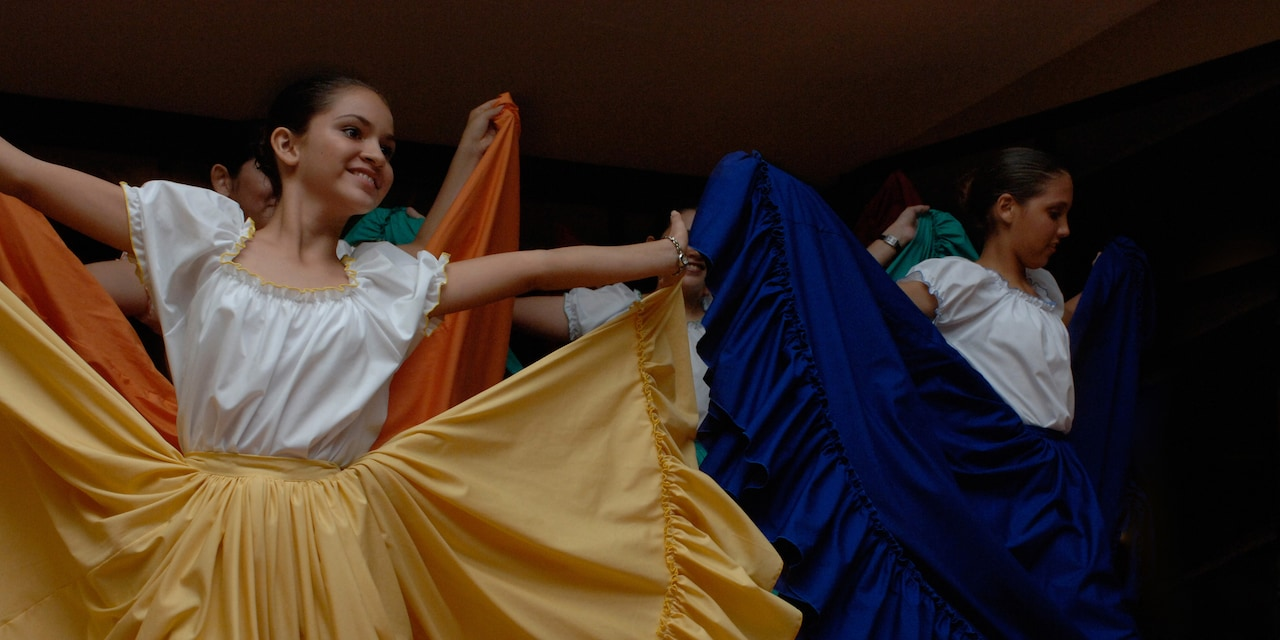 Women dance in traditional Costa Rican costumes