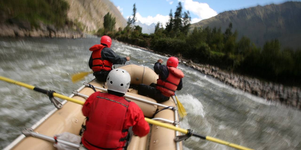 3 tourists raft down a river