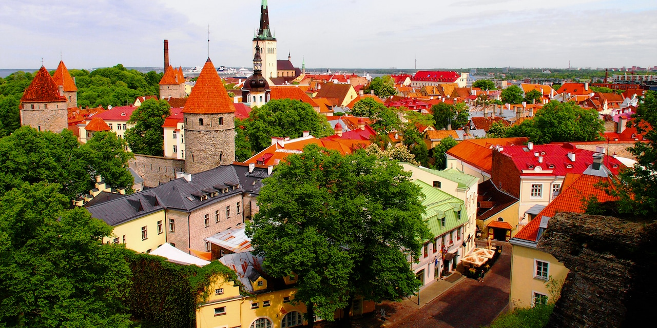 The rooftops, spires and cobblestone streets of the town of Tallin, Estonia