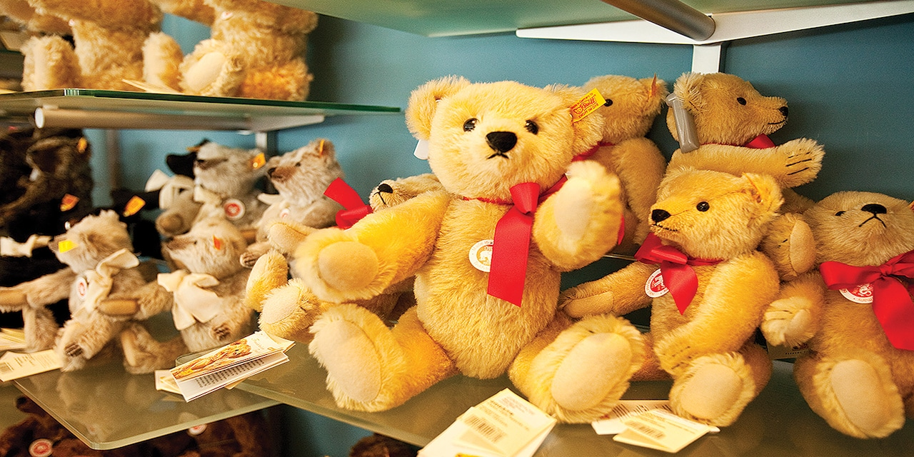 Teddy bears and other plush animals on shelves
