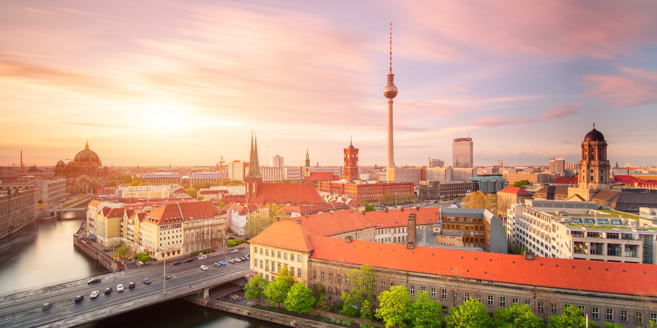 The skyline of Berlin, featuring the Fernsehturm Berlin television tower, with the Spree River flowing through