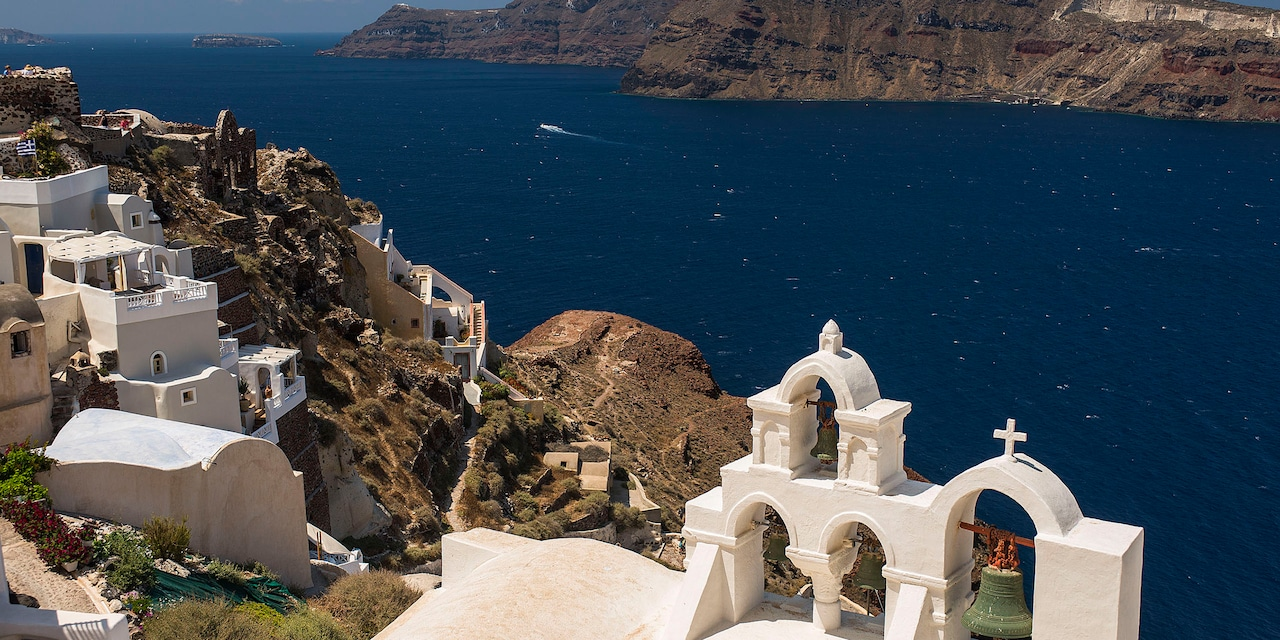 The whitewashed, cliffside buildings of the village of Crete overlooking the Aegean Sea