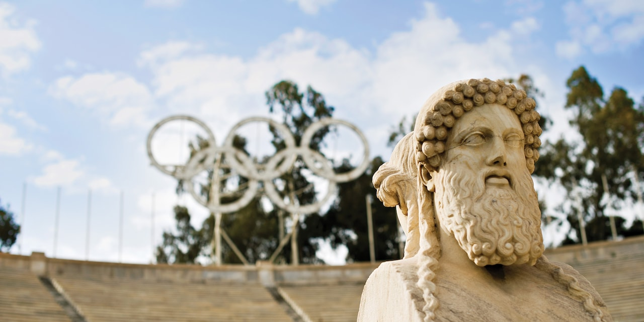 The Panathenaic Stadium in Greece, with a marble statue of a god and Olympic rings
