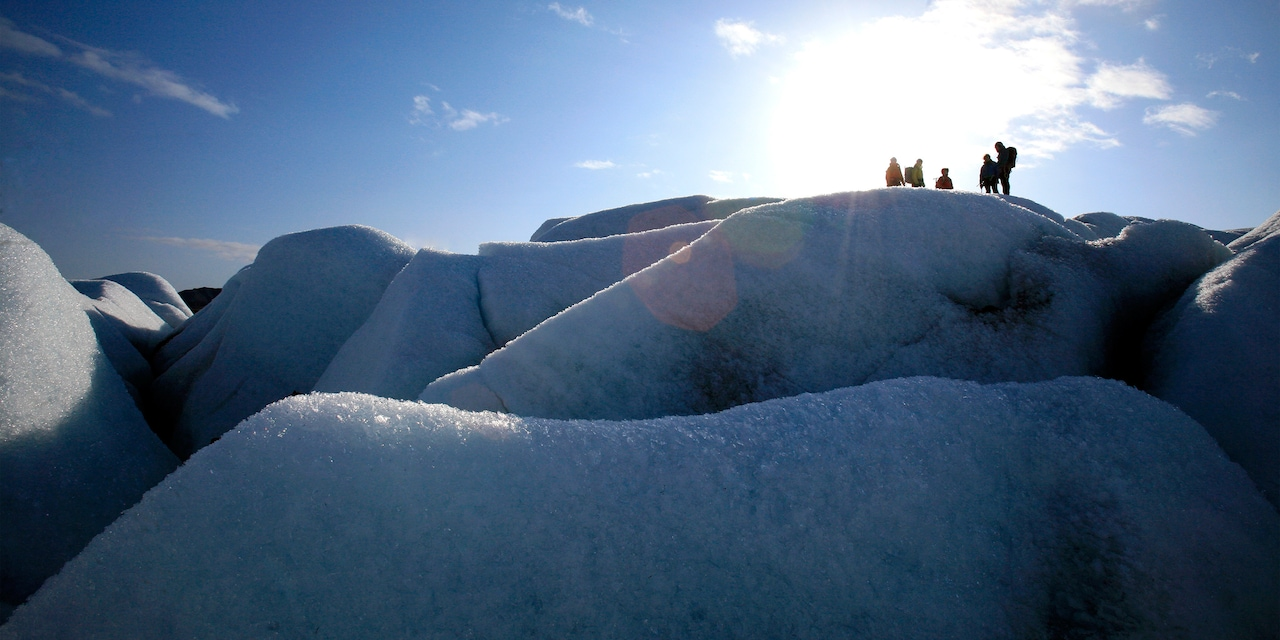 Several Adventurers are high atop a glacier during a glacier hike