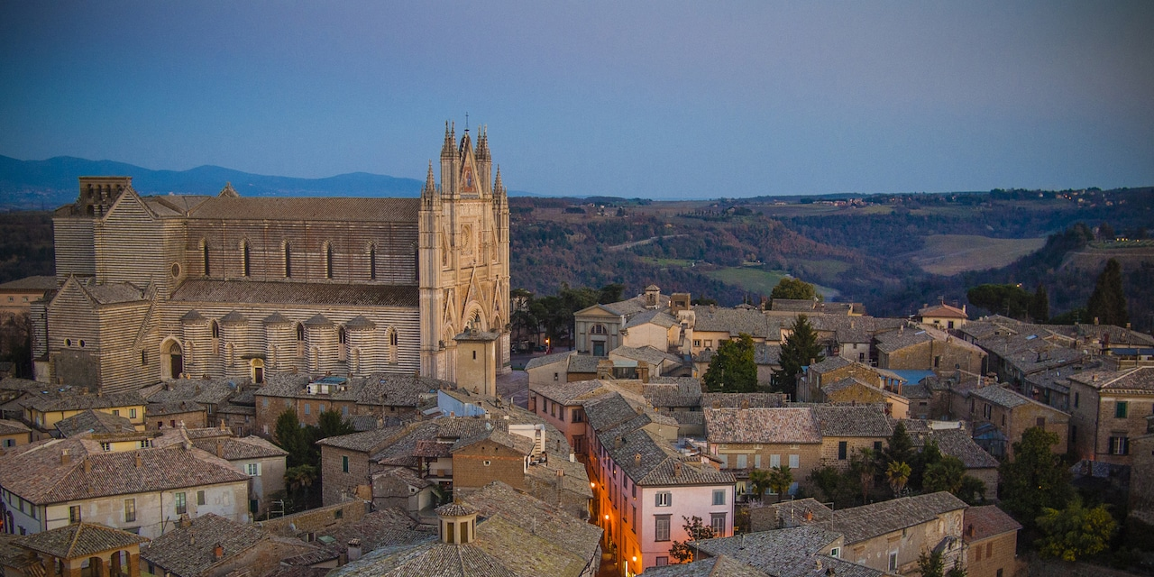 The rooftops and cathedral of Orvieto, Italy at dusk