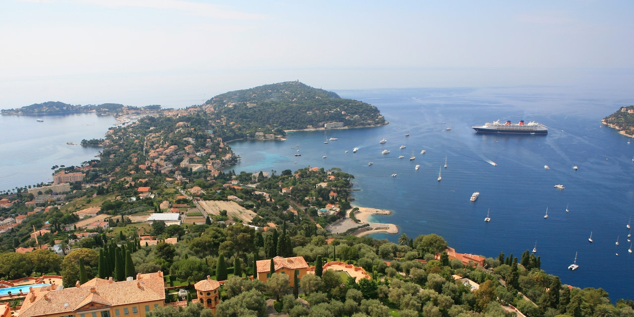 Villefranche Harbor with a few sailboats and a coastal village