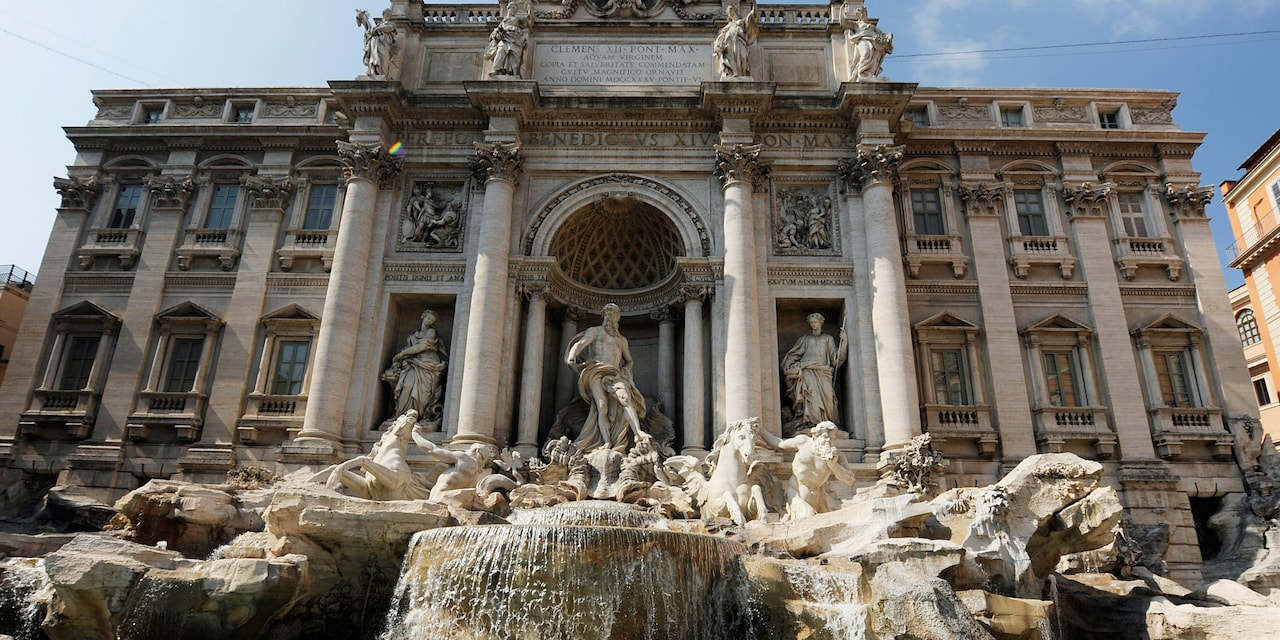 The Trevi Fountain adorned with beautiful statues in Rome, Italy