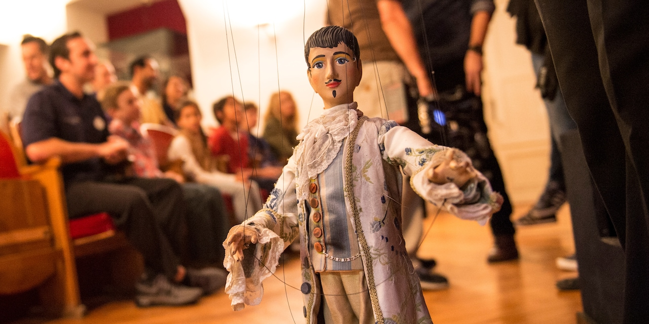 A handmade male marionette, wearing formal 1700s attire