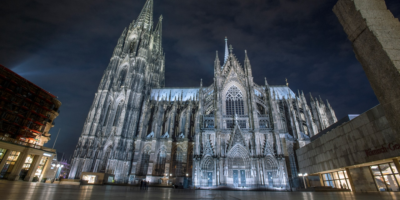 At night, a lit gothic cathedral