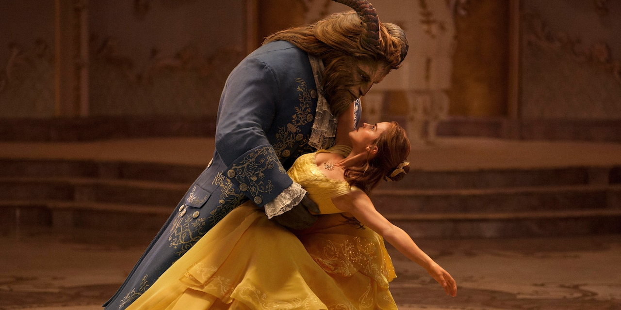 Belle and the Beast dance in a grand ballroom