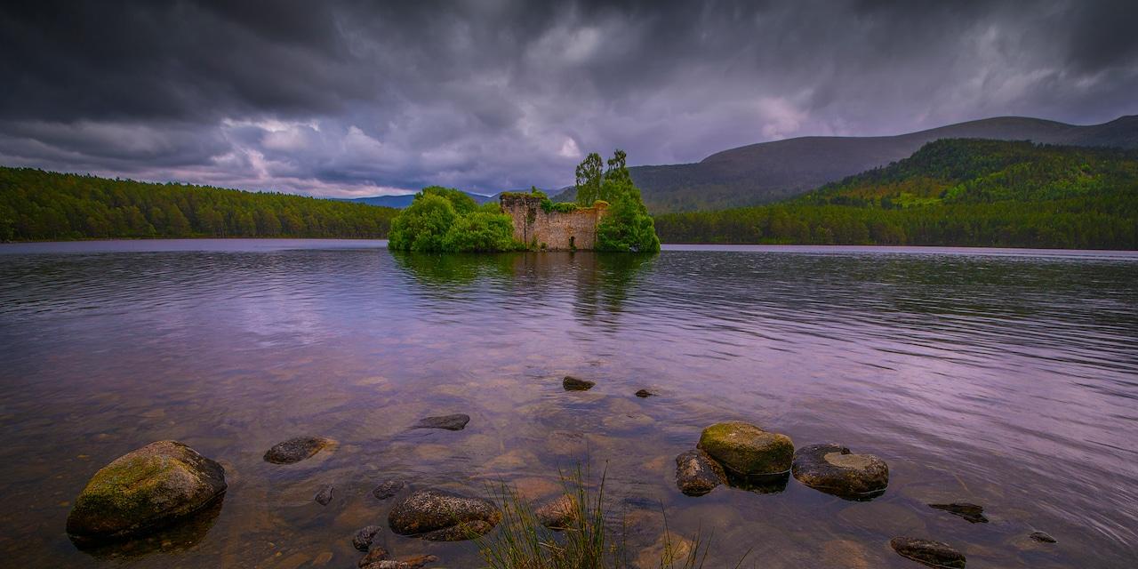 Loch an Eilein Castle sits on an island in Loch an Eilein