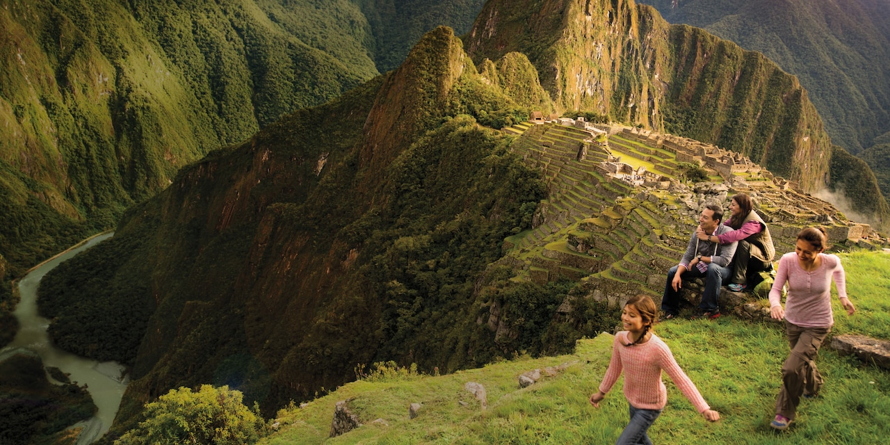 A family of 4 visits the ancient Incan ruins of Machu Picchu in Peru
