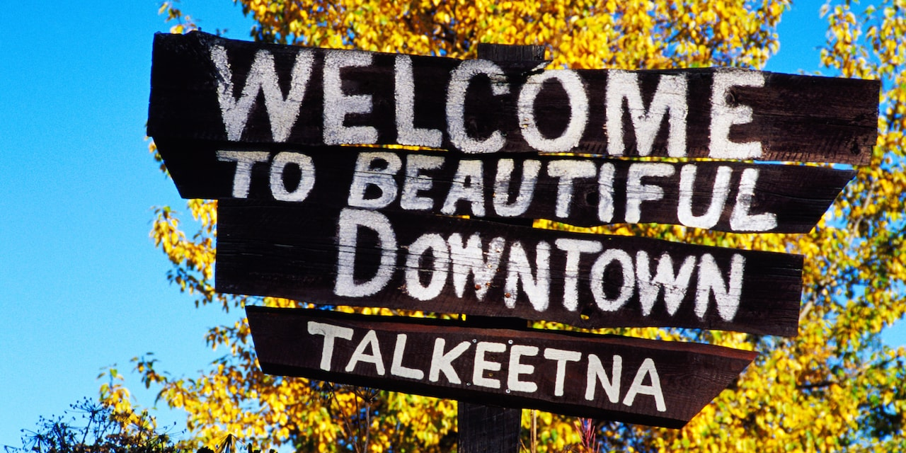 A sign reads 'Welcome to beautiful downtown Talkeetna'