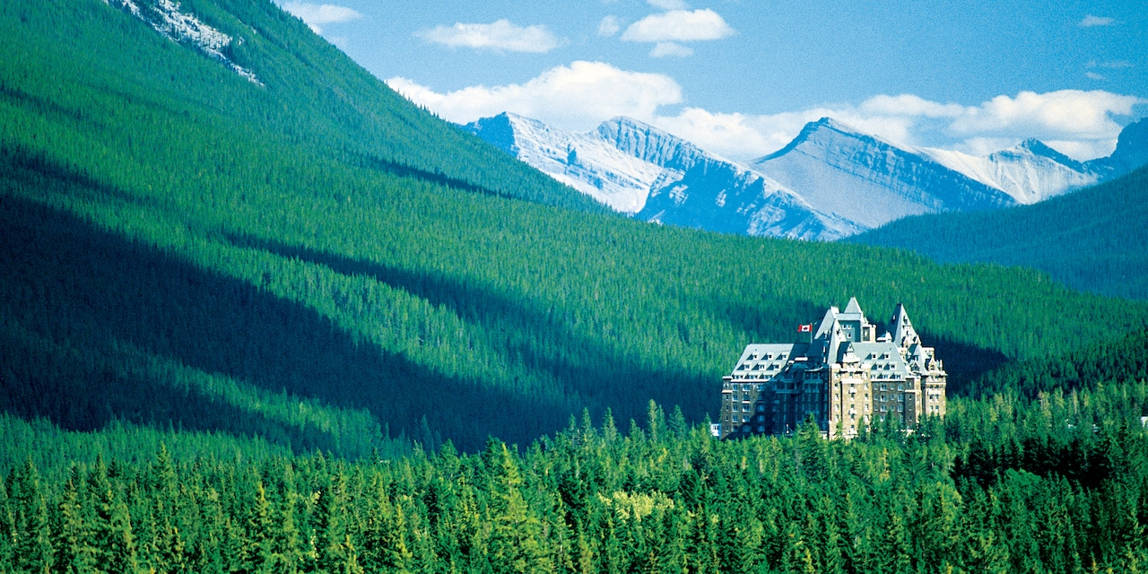 The Fairmont Banff Springs Hotel and the surrounding tree-covered mountains