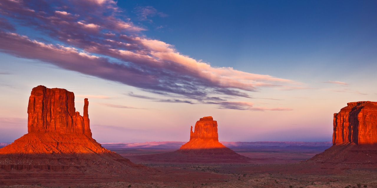 Buttes and rock formations in Monument Valley at sunset