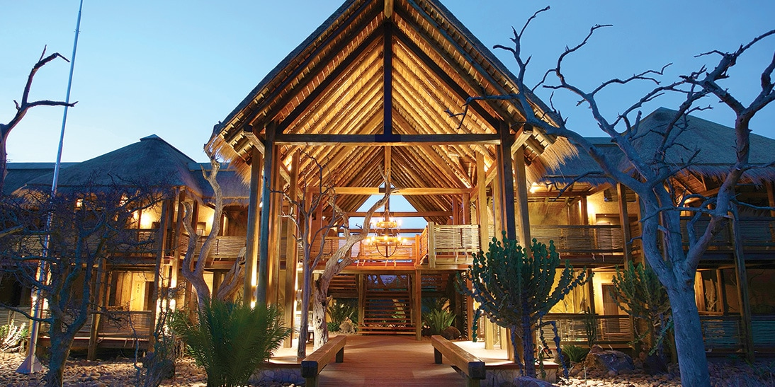 The impressive arched entrance to the Kapama River Lodge at twilight